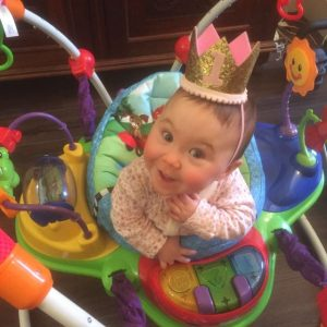 Edie wearing a crown for her first birthday